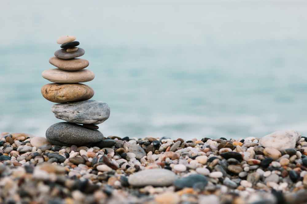 Stack of peaceful and calm pebble stones on ocean.